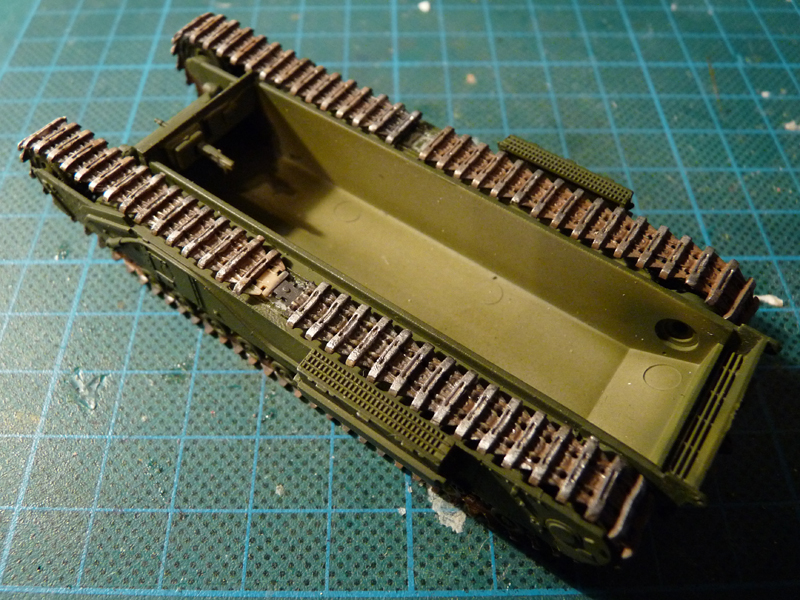Tracks glued to suspension and hull