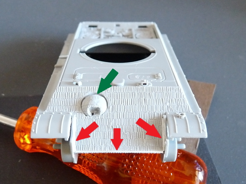 The Panther's front. Red arrows point to shims, green arrow shows a gap yet to be filled.