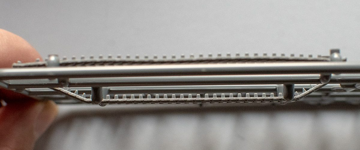 Note changing guide teeth shape on lower track run